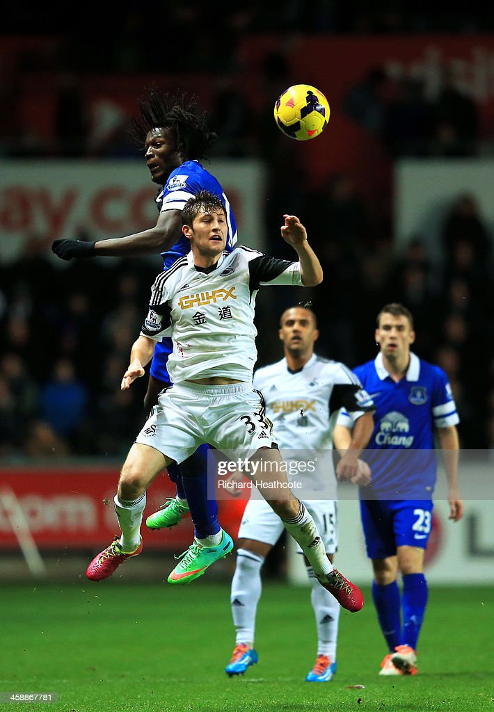 Ben Davies of Swansea and Romelu Lukaku of Everton battle for a header during the Barclays Premier League match between Swansea City and Everton at the Liberty Stadium on December 22, 2013 in Swansea, Wales.