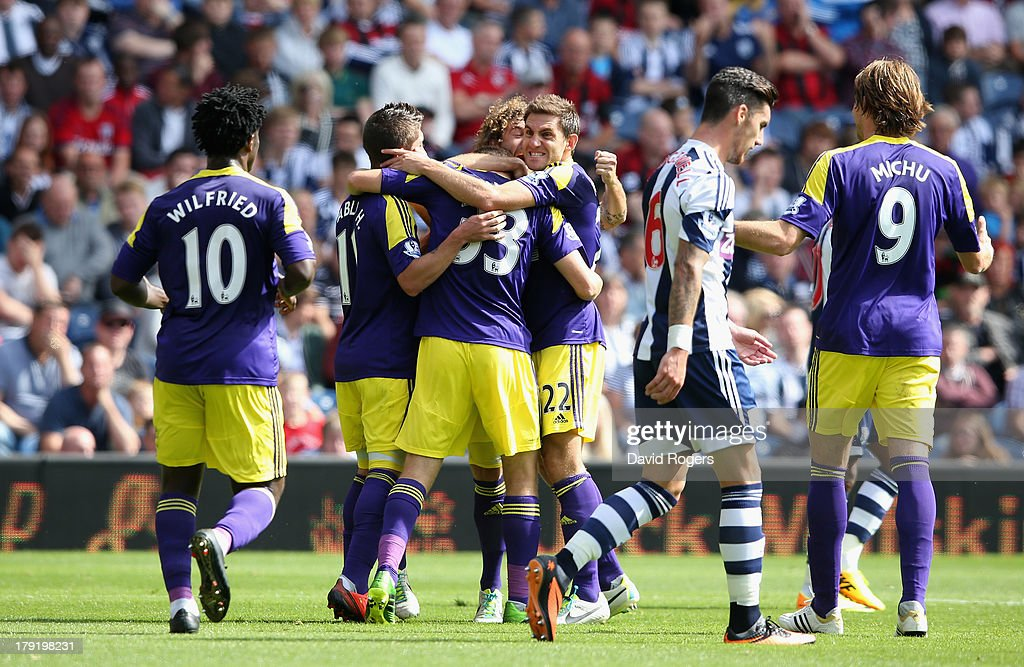 Ben Davies of Swansea City celebrates with team mates after scoring the first goal during the Barclays Premier League match between West Bromwich Albion and Swansea City at The Hawthorns on September 01, 2013 in West Bromwich, England.