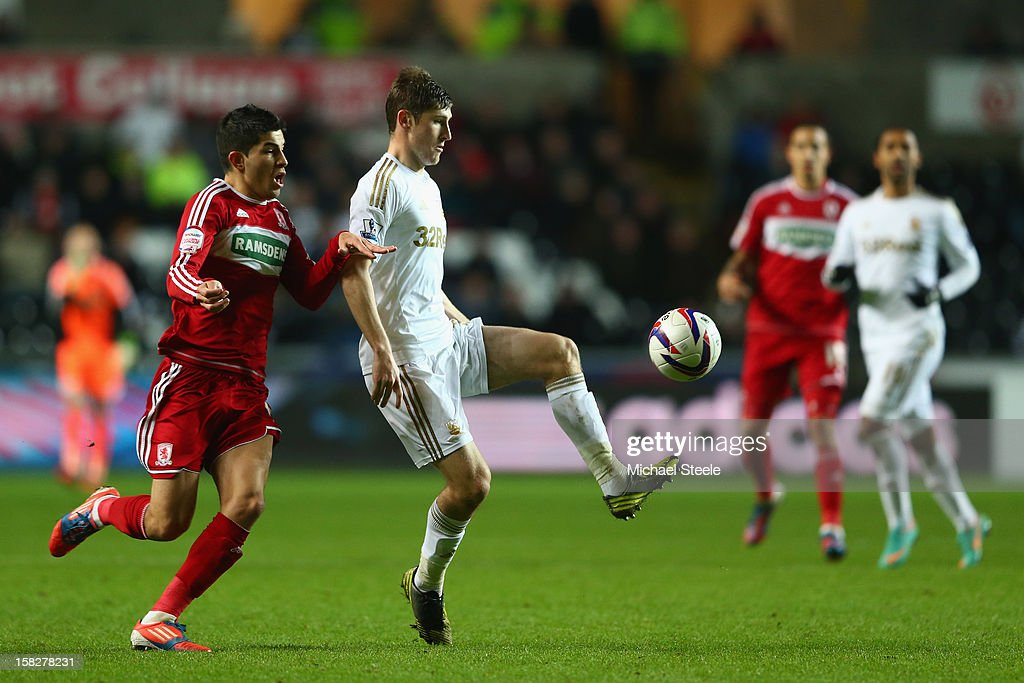 Ben Davies (2L) of Swansea City under pressure from Emmanuel Ledesma (L) of Middlesbrough during the Capital One Cup Quarter-Final match between Swansea City and Middlesbrough at the Liberty Stadium on December 12, 2012 in Swansea, Wales.