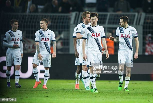 Ben Davies of Tottenham and his teammates react after the UEFA Europa League Round of 16 First Leg match between Borussia Dortmund and Tottenham...
