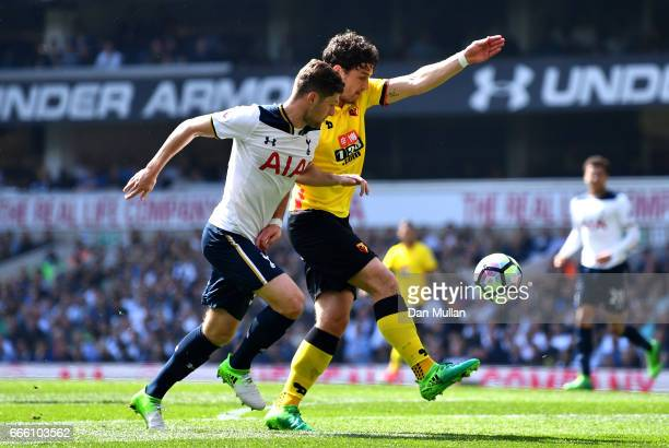 Ben Davies of Tottenham Hotspur and Daryl Janmaat of Watford Battle for possession during the Premier League match between Tottenham Hotspur and...