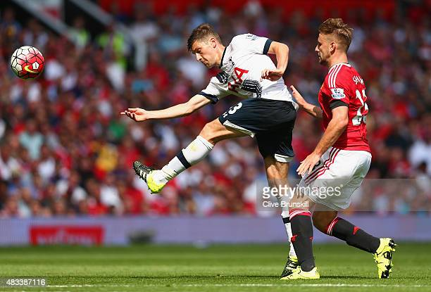 Ben Davies of Tottenham Hotspur and Morgan Schneiderlin of Manchester United compete for the ball during the Barclays Premier League match between...