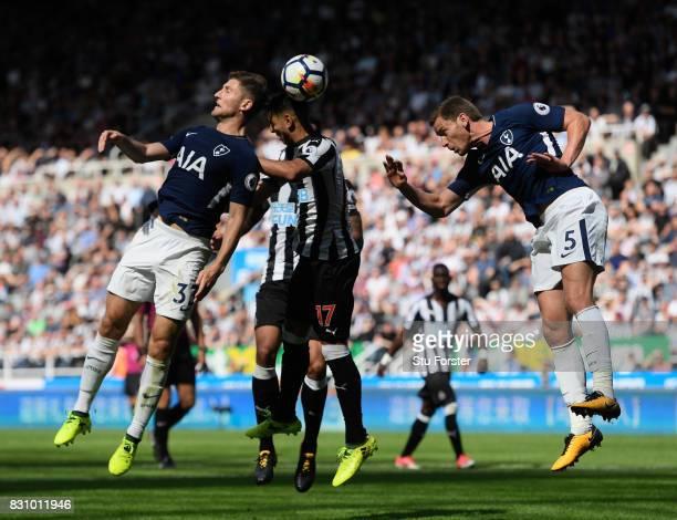 Ben Davies of Tottenham Hotspur Ayoze Perez of Newcastle United and Jan Vertonghen of Tottenham Hotspur battle to win a header during the Premier...