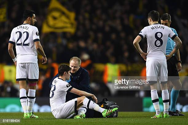 Ben Davies of Tottenham Hotspur is given treatment during the UEFA Europa League round of 16 second leg match between Tottenham Hotspur and Borussia...