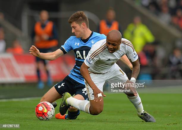 Ben Davies of Tottenham Hotspur tackles Andre Ayew of Swansea City during the Barclays Premier League match between Swansea City and Tottenham...