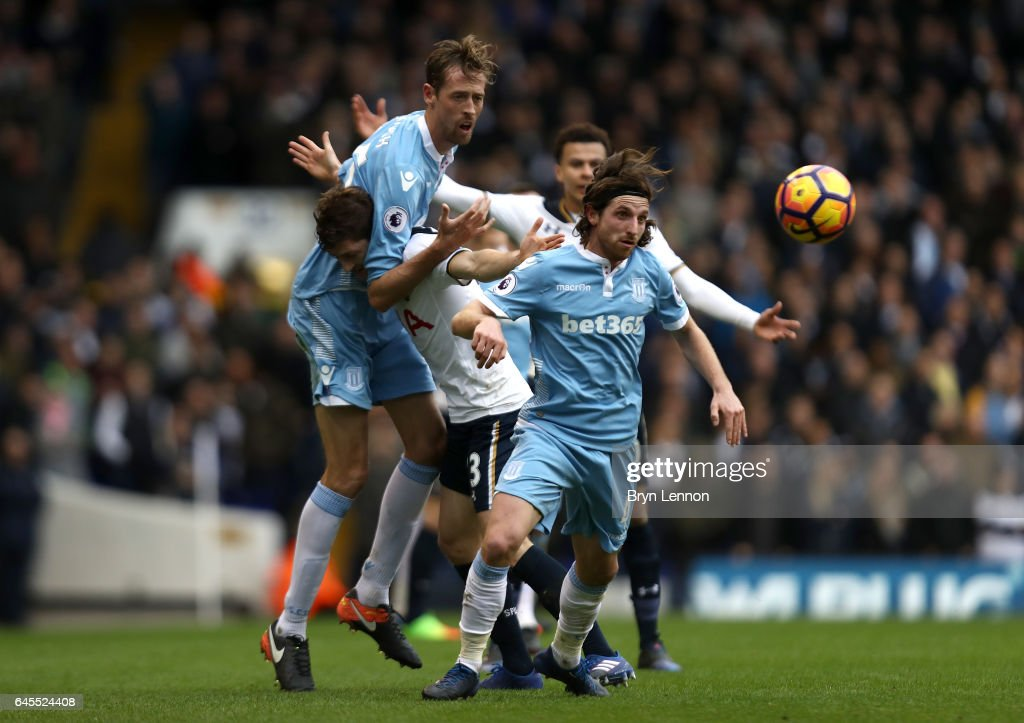 Ben Davies of Tottenham Hotspur tangles with Peter Crouch and Joe Allen of Stoke City during the Premier League match between Tottenham Hotspur and Stoke City at White Hart Lane on February 26, 2017 in London, England.