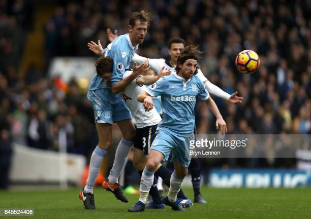 Ben Davies of Tottenham Hotspur tangles with Peter Crouch and Joe Allen of Stoke City during the Premier League match between Tottenham Hotspur and...