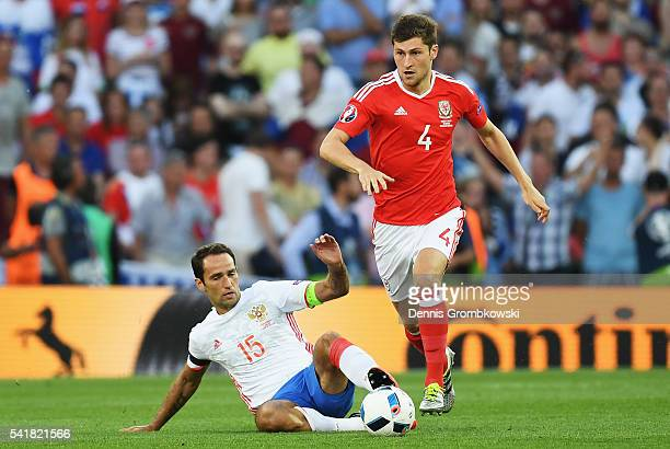 Ben Davies of Wales and Roman Shirokov of Russia compete for the ball during the UEFA EURO 2016 Group B match between Russia and Wales at Stadium...
