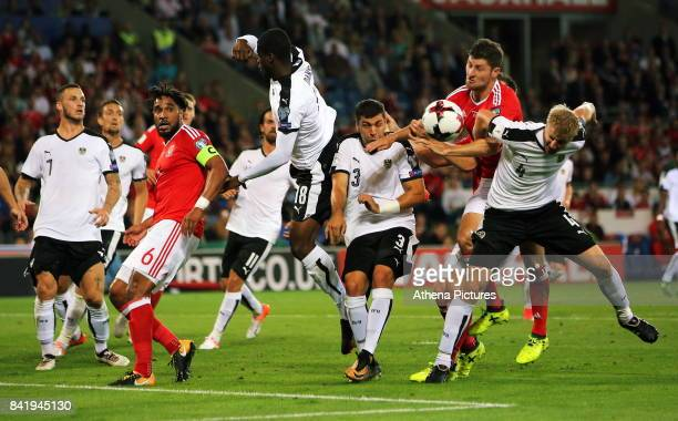 Ben Davies of Wales attempts to get the ball over Aleksandar Dragovic and Martin Hinteregger of Austria during the FIFA World Cup Qualifier Group D...