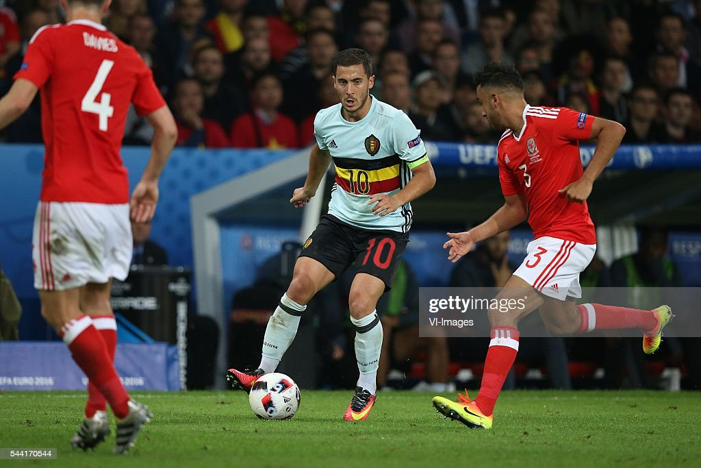 Ben Davies of Wales, Eden Hazard of Belgium, Neil Taylor of Wales during the UEFA EURO 2016 quarter final match between Wales and Belgium on July 2, 2016 at the Stade Pierre Mauroy in Lille, France.