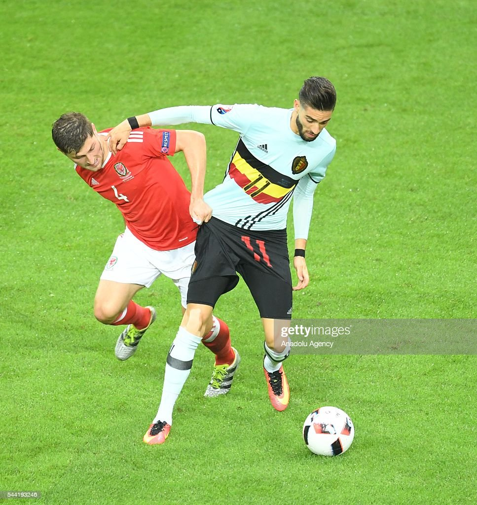 Ben Davies of Wales (L) in action against Yannick Carrasco (R) of Belgium during the Euro 2016 quarter-final football match between Wales and Belgium at the Stadium Pierre Mauroy in Lille, France on July 1, 2016.