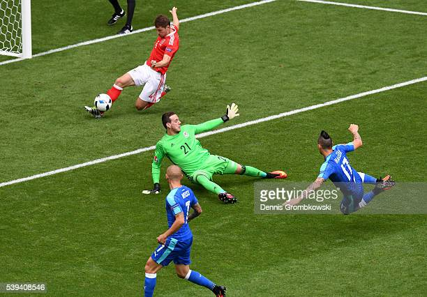Ben Davies of Wales slides to clear the ball during the UEFA EURO 2016 Group B match between Wales and Slovakia at Stade Matmut Atlantique on June 11...