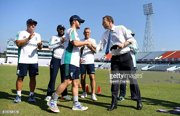Ben Duckett of England is presented with his test cap by former captain Michael Atherton ahead of the first Test match between Bangladesh and England...