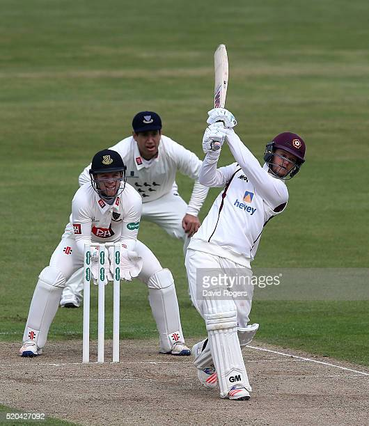 Ben Duckett of Northamptonshire hits a six during the Specsavers County Championship division two match between Northamptonshire and Sussex at the...