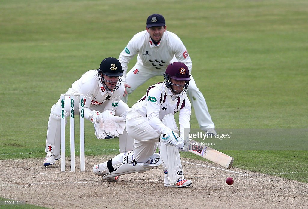 Ben Duckett of Northamptonshire sweeps the ball for four runs during the Specsavers County Championship division two match between Northamptonshire...