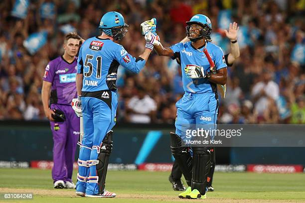Ben Dunk and Chris Jordan of the Adelaide Strikers celebrate after the Stikers won the Big Bash League match between the Adelaide Strikers and the...