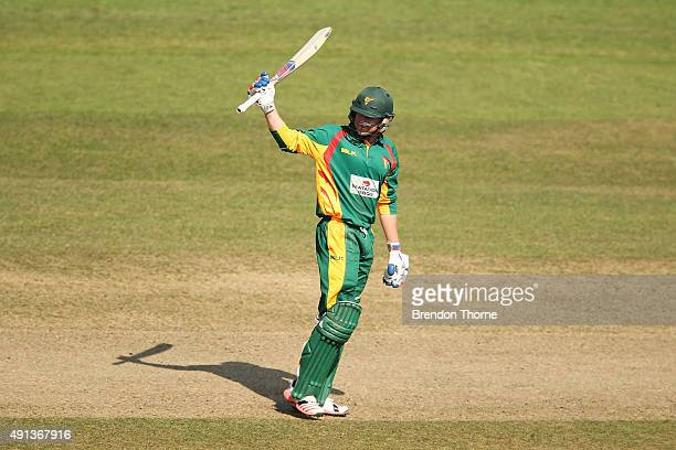 Ben Dunk of Tasmania celebrates scoring a half century during the Matador BBQs One Day Cup match between Queensland and Tasmania at North Sydney Oval...
