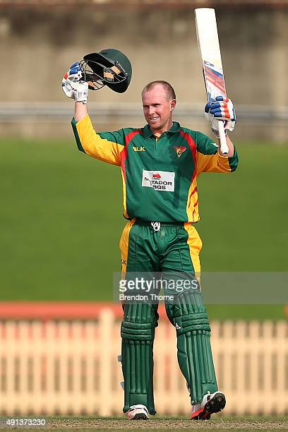 Ben Dunk of Tasmania celebrates scoring his century during the Matador BBQs One Day Cup match between Queensland and Tasmania at North Sydney Oval on...