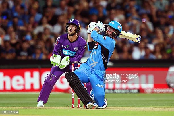 Ben Dunk of the Adelaide Strikers bats in front of Tim Paine of the Hobart Hurricanes during the Big Bash League match between the Adelaide Strikers...