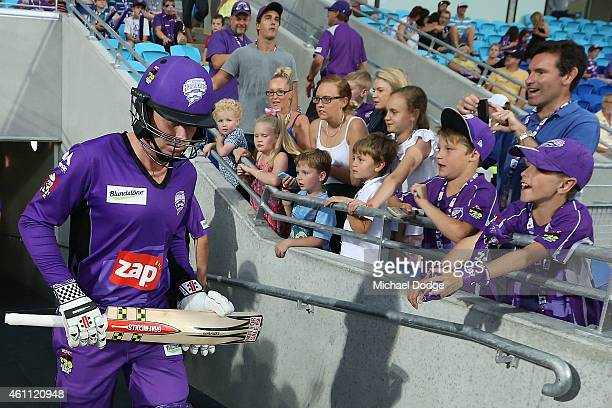 Ben Dunk of the Hurricanes walks onto the field of play to start their innings during the Big Bash League match between the Hobart Hurricanes and the...
