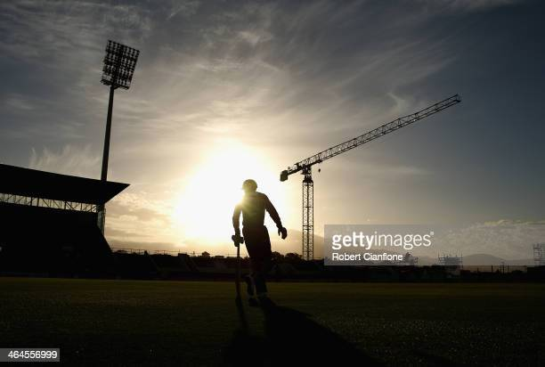 Ben Dunk of the Hurricanes walks out to bat during the Big Bash League match between the Hobart Hurricanes and Brisbane Heat at Blundstone Arena on...