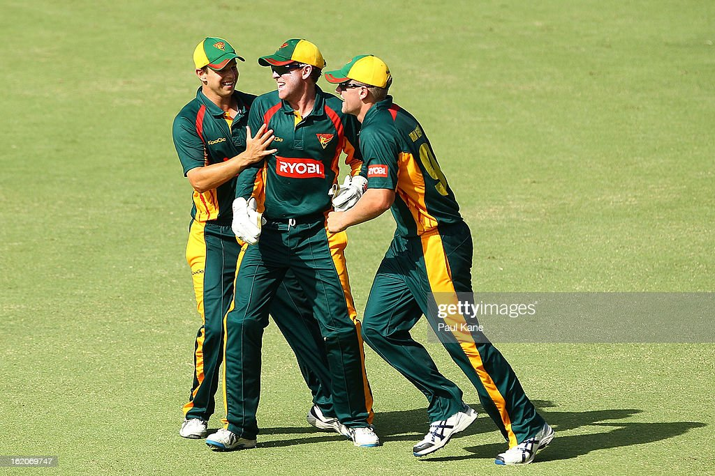 Ben Dunk of the Tigers is congratulated by Evan Gulbis (L) and Timm van der Gugten after catching Michael Hussey of the Warriors during the Ryobi One Day Cup match between the Western Australia Warriors and the Tasmanian Tigers at the WACA on February 19, 2013 in Perth, Australia.