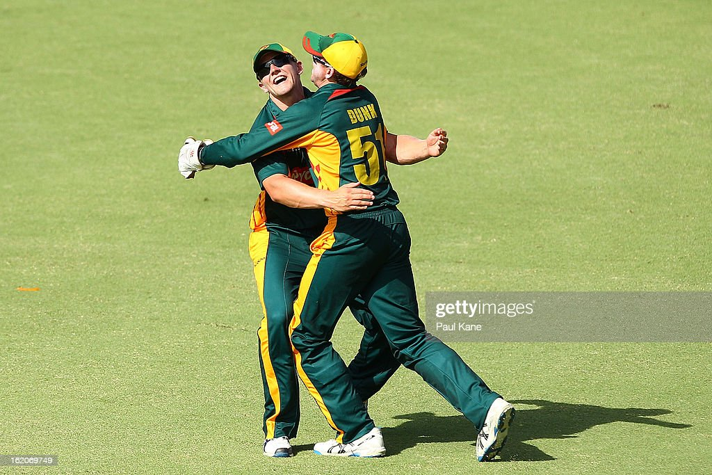 Ben Dunk of the Tigers is congratulated Timm van der Gugten after catching Michael Hussey of the Warriors during the Ryobi One Day Cup match between the Western Australia Warriors and the Tasmanian Tigers at the WACA on February 19, 2013 in Perth, Australia.