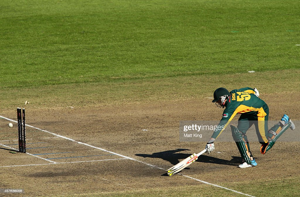 Ben Dunk of the Tigers is runout during the Matador BBQs One Day Cup match between Tasmania and South Australia at North Sydney Oval on October 22...
