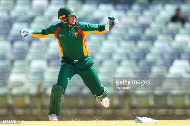 Ben Dunk of the Tigers looks for a run out during the JLT One Day Cup match between Victoria and Tasmania at WACA on October 4 2017 in Perth Australia