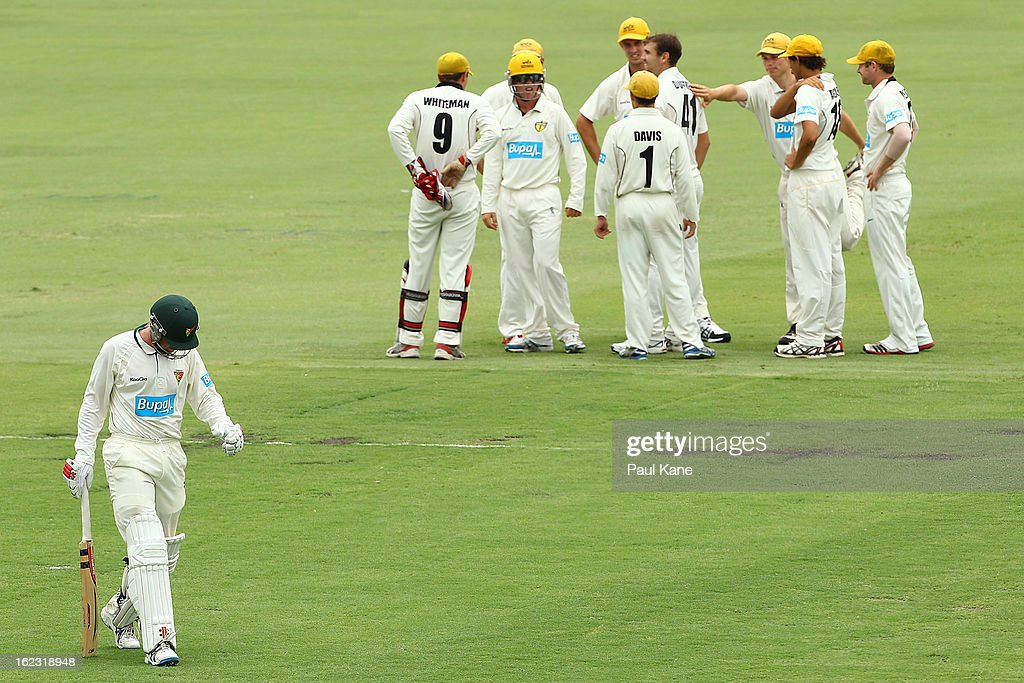 Ben Dunk of the Tigers walks back to the rooms after being dismissed by Ryan Duffield of the Warriors during day two of the Sheffield Shield match between the Western Australia Warriors and the Tasmania Tigers at WACA on February 22, 2013 in Perth, Australia.