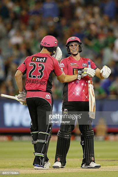 Ben Dwarshuis and Sean Abbott of the Sydney Sixers celebrate the win at the end of the Big Bash League match between the Melbourne Stars and the...