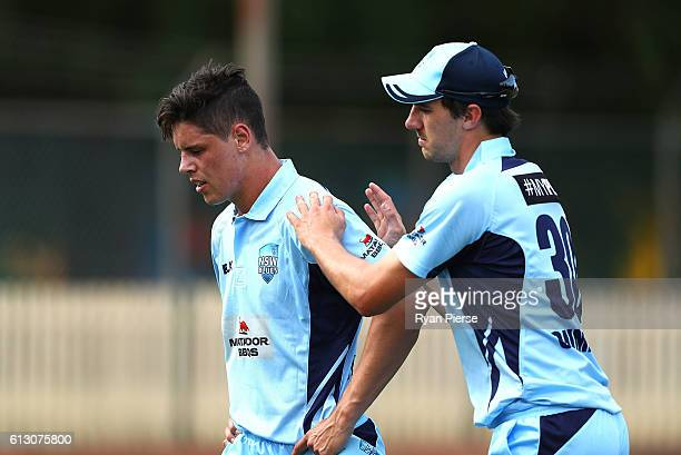 Ben Dwarshuis of the Blues is consoled by Pat Cummins of the Blues as he leaves the field after suffering an injury while bowling during the Matador...