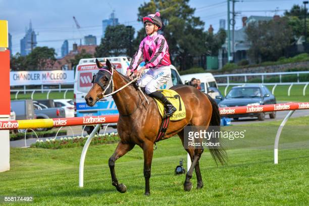 Ben E Thompson returns to the mounting yard on Kawabata after winning the TSOLS TIPS Handicap at Moonee Valley Racecourse on October 06 2017 in...