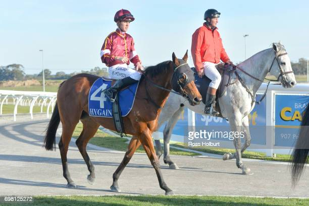 Ben E Thompson returns to the mounting yard on Miss Clooney after winning the IGA Liquor BM70 Handicap at Racingcom Park Synthetic Racecourse on June...