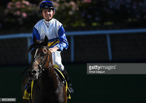 Ben E Thompson riding Smart Dart after winning Race 8 during Melbourne Racing at Moonee Valley Racecourse on January 21 2017 in Melbourne Australia