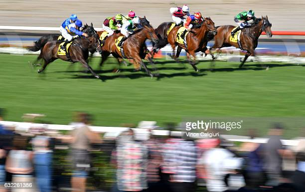 Ben E Thompson riding Smart Dart flashes home to win Race 8 during Melbourne Racing at Moonee Valley Racecourse on January 21 2017 in Melbourne...