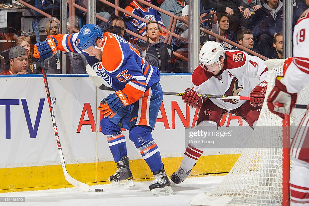 <a gi-track='captionPersonalityLinkClicked' href=/galleries/search?phrase=Ben+Eager&family=editorial&specificpeople=570537 ng-click='$event.stopPropagation()'>Ben Eager</a> #55 of the Edmonton Oilers battles for the puck against <a gi-track='captionPersonalityLinkClicked' href=/galleries/search?phrase=Zbynek+Michalek&family=editorial&specificpeople=243230 ng-click='$event.stopPropagation()'>Zbynek Michalek</a> #4 of the Minnesota Wild during an NHL game at Rexall Place on February 23, 2013 in Edmonton, Alberta, Canada.