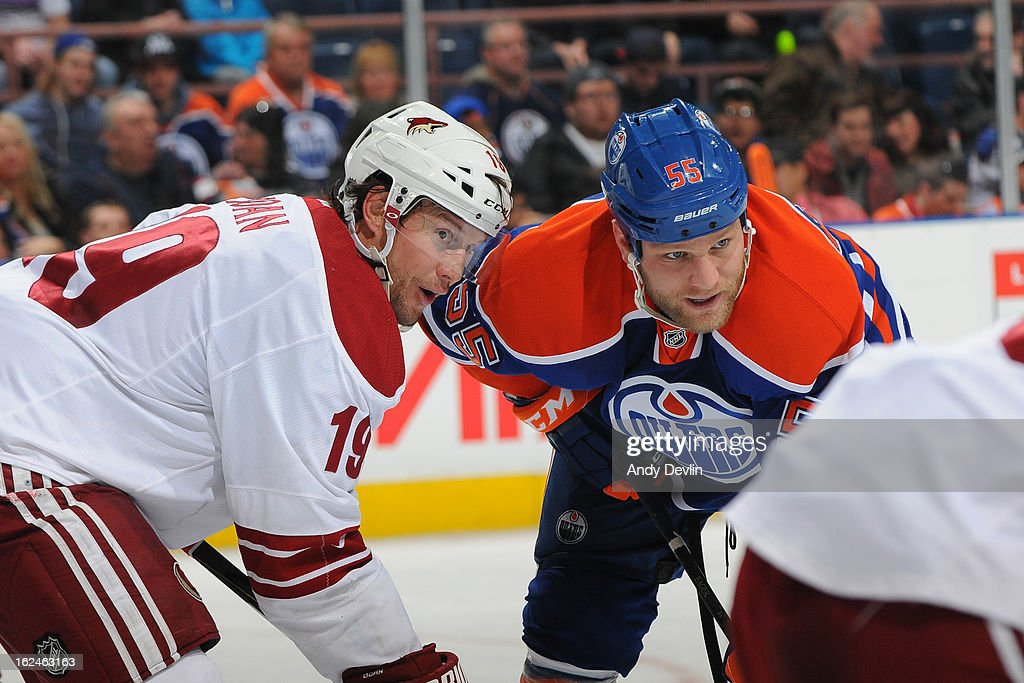 <a gi-track='captionPersonalityLinkClicked' href=/galleries/search?phrase=Ben+Eager&family=editorial&specificpeople=570537 ng-click='$event.stopPropagation()'>Ben Eager</a> #55 of the Edmonton Oilers lines up for a face off against <a gi-track='captionPersonalityLinkClicked' href=/galleries/search?phrase=Shane+Doan&family=editorial&specificpeople=201614 ng-click='$event.stopPropagation()'>Shane Doan</a> #19 of the Phoenix Coyotes on February 23, 2013 at Rexall Place in Edmonton, Alberta, Canada.