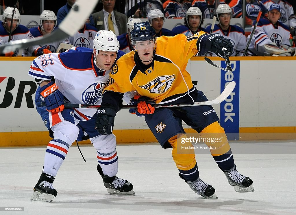 <a gi-track='captionPersonalityLinkClicked' href=/galleries/search?phrase=Ben+Eager&family=editorial&specificpeople=570537 ng-click='$event.stopPropagation()'>Ben Eager</a> #55 of the Edmonton Oilers skates against Bobby Butler #19 of the Nashville Predators at Bridgestone Arena on March 8, 2013 in Nashville, Tennessee.