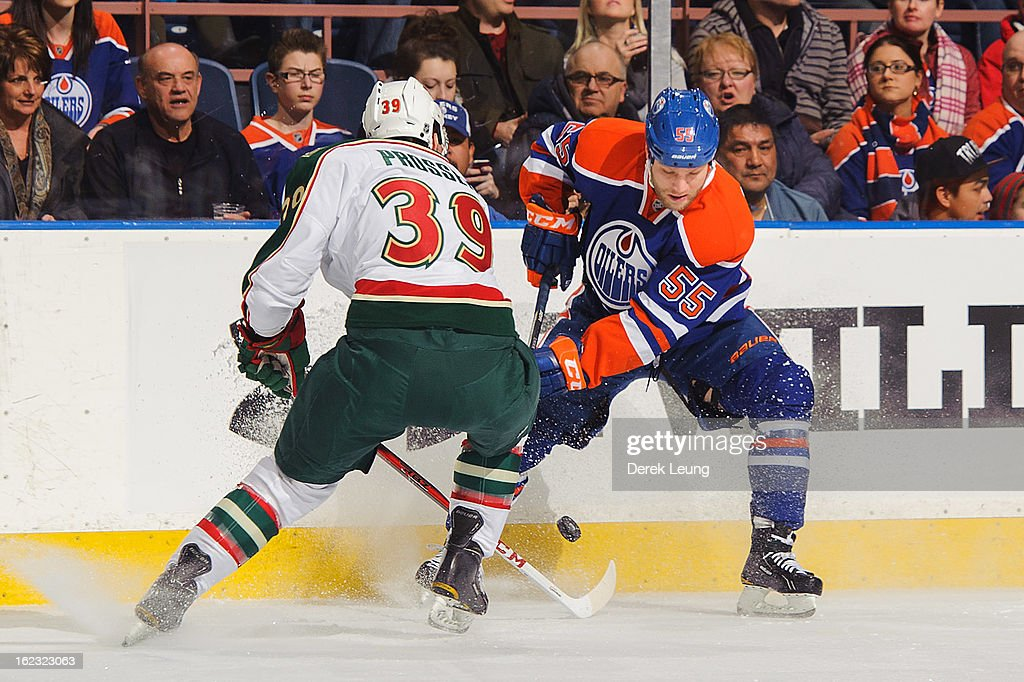 Ben Eager #55 of the Edmonton Oilers skates with the puck against Nate Prosser #39 of the Minnesota Wild during an NHL game at Rexall Place on February 21, 2013 in Edmonton, Alberta, Canada.