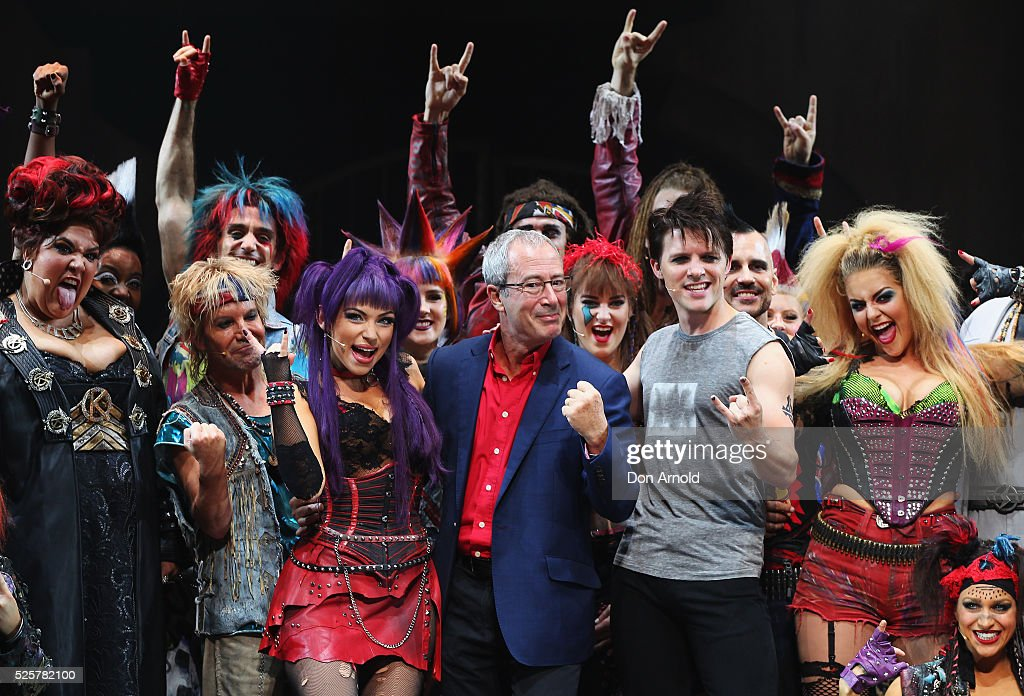 Ben Elton (C) stands alongside cast members during the 'We Will Rock You' media call at Lyric Theatre, Star City on April 29, 2016 in Sydney, Australia.
