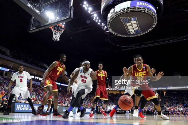 Ben Emelogu II of the Southern Methodist Mustangs and De'Anthony Melton of the USC Trojans compete for a loose ball during the first round of the...