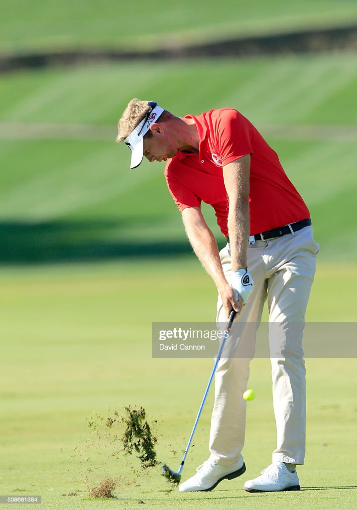 Ben Evans of England plays his second shot at the par 4, first hole during the third round of the 2016 Omega Dubai Desert Classic on the Majlis Course at the Emirates Golf Club on February 6, 2016 in Dubai, United Arab Emirates.