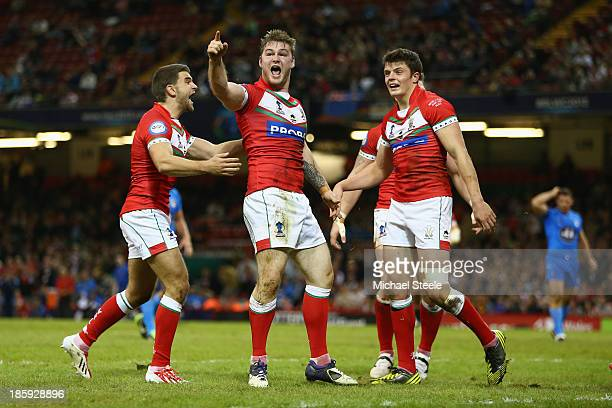Ben Evans of Wales celebrates scoring his sides opening try during the Rugby League World Cup Inter group match between Wales and Italy at the...