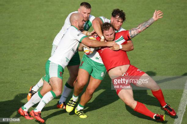 Ben Evans of Wales is tackled by Liam Finn of Ireland during the 2017 Rugby League World Cup match between Wales and Ireland at nib Stadium on...