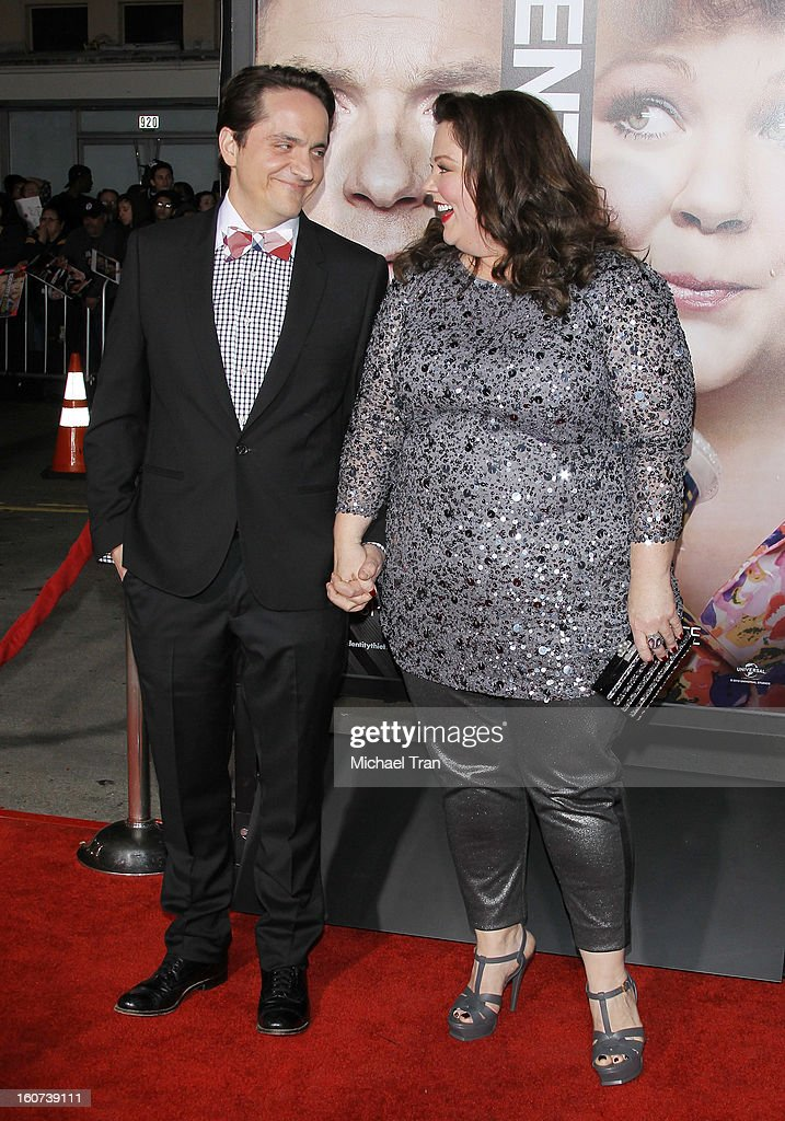 Ben Falcone (L) and Melissa McCarthy arrive at the Los Angeles premiere of 'Identity Thief' held at Mann Village Theatre on February 4, 2013 in Westwood, California.