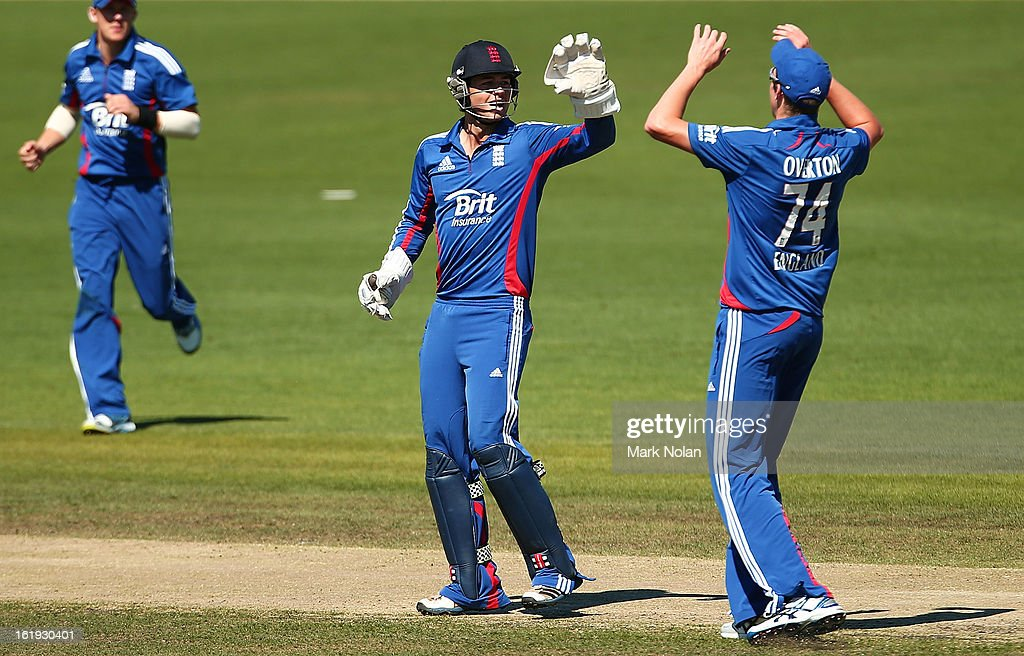 Ben Foakes (C) and Craig Overton (R) of the Lions celebrate the run out of Alex Doolan of Australia A during the international tour match between Australia 'A' and England at Blundstone Arena on February 18, 2013 in Hobart, Australia.