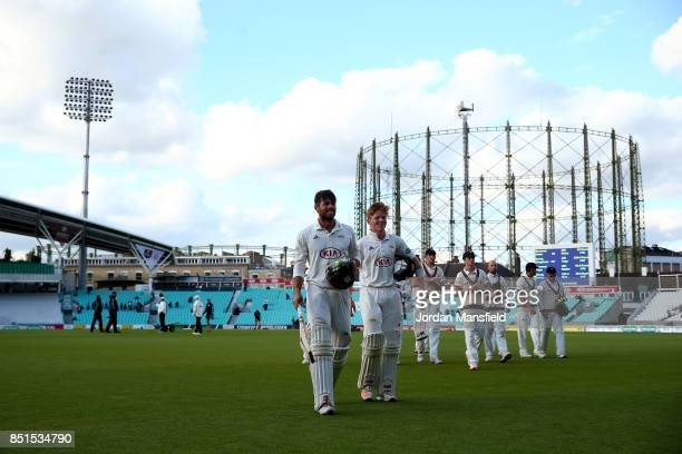 Ben Foakes and Ollie Pope of Surrey leave the field after making the final runs to win the match for Surrey during day four of the Specsavers County...
