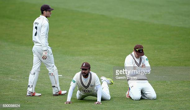 Ben Foakes Kumar Sangakkara and Jason Roy of Surrey reacts after missed a chance during day three of the Specsavers County Championship Division One...