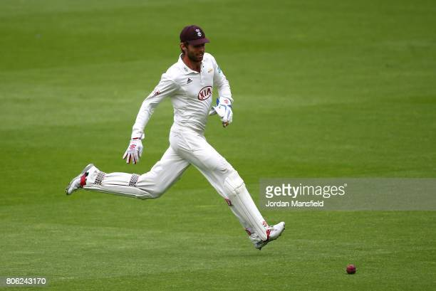Ben Foakes of Surrey fields the ball during day one of the Specsavers County Championship Division One match between Surrey and Hampshire at The Kia...